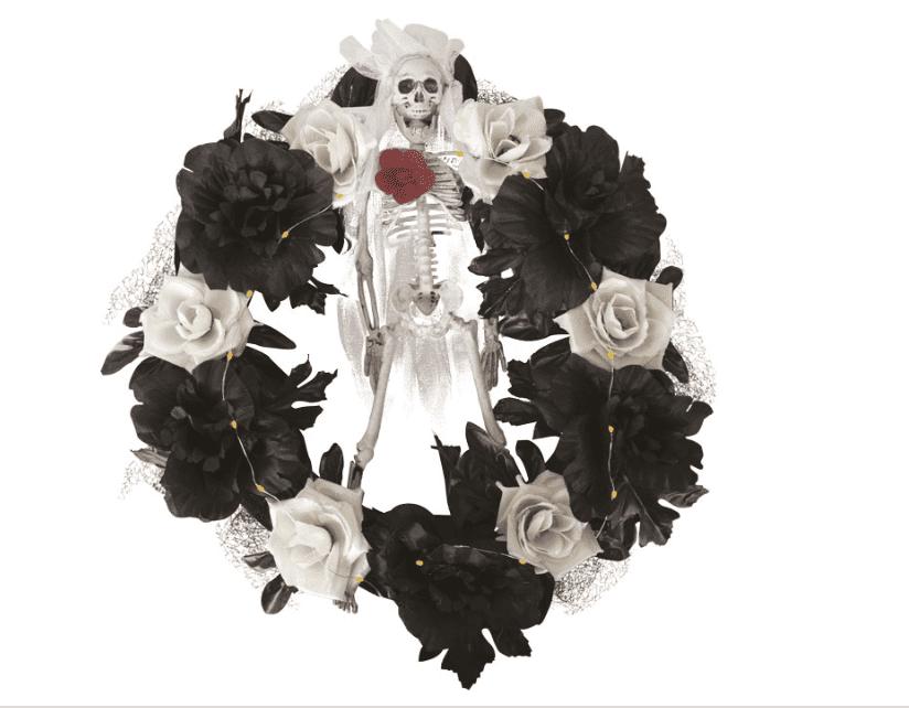 Beleuchteter Blumenkranz mit Skelett